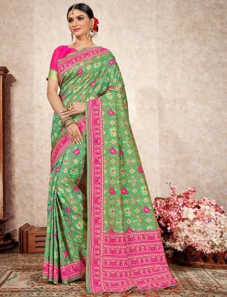 Elegent green wedding wear patola silk saree