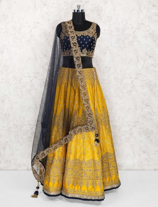 Embroidered wedding wear yellow color raw silk lehenga choli