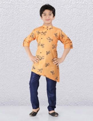 Ethnic orange hued printed cotton kurta suit