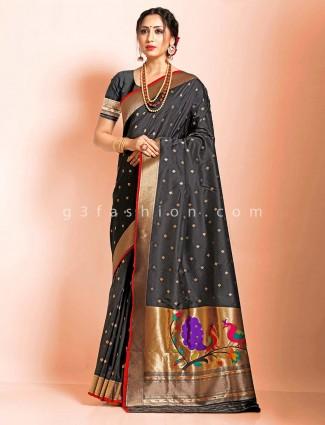 Evening party wear black art banarasi silk saree in paithani pallu