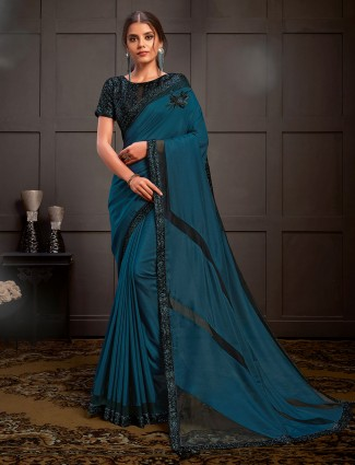Exclusive embroidered teal blue silk georgette saree for party