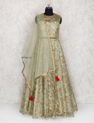 Exclusive green color floor length anarkali suit in net fabric