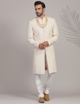 Exclusive heavy embroidered cream sherwani in silk