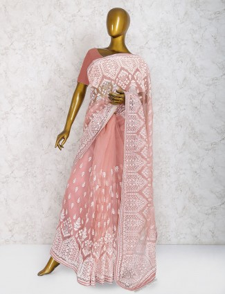 Exclusive peach colored party wear saree