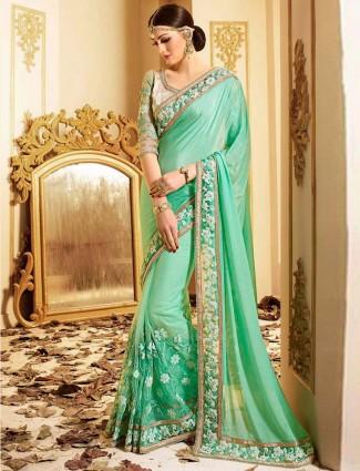 Faux georgette green party wear saree