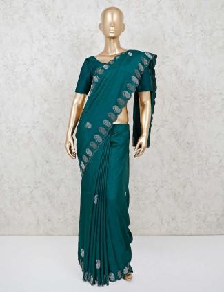 Festive bottle green dola silk saree