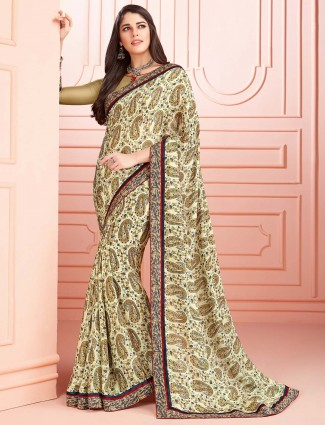 Festive wear cream colored georgette saree