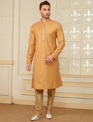 Festive wear mustard yellow hued kurta suit
