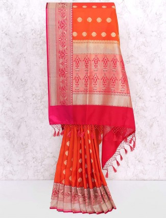 Festive wear orange hued semi silk saree