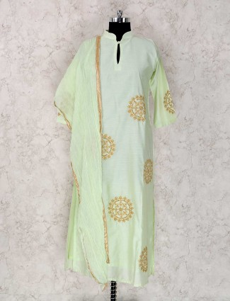 Festive wear sharara suit in green color