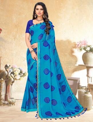 Fine blue colored printed georgette saree