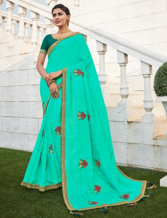 Firozi color saree with teal green embroidered blouse piece