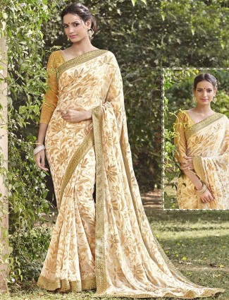 Georgette brasso cream festive wear saree