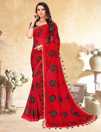 Georgette red colored saree with print