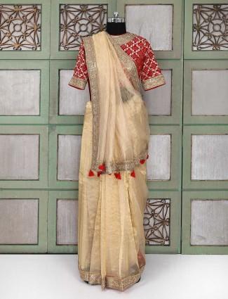 Golden color organza tissue party wear saree