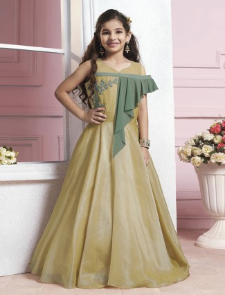 Golden color silk designer gown for cute girls