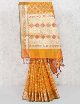 Golden hue wedding banarasi semi silk saree