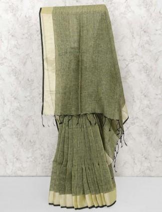 Gorgeous green color linen fabric saree