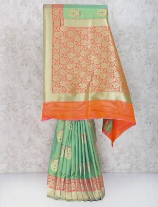 Gorgeous green color semi silk festive sari