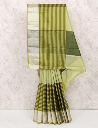 Gorgeous green colored cotton silk saree