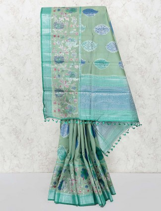 Gorgeous green colored semi silk fabric saree