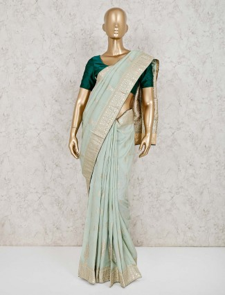 Gorgeous light green dola silk saree