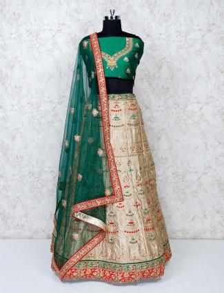 Green and beige raw silk classic semi stitched lehenga choli