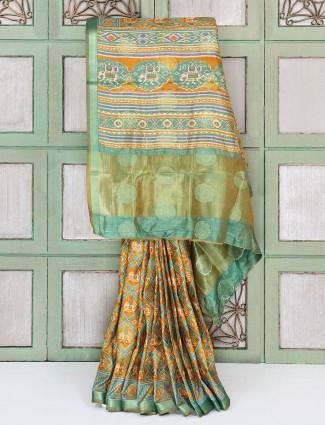 Green and orange festive printed saree