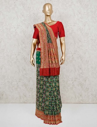 Green and red patola silk saree for weddings