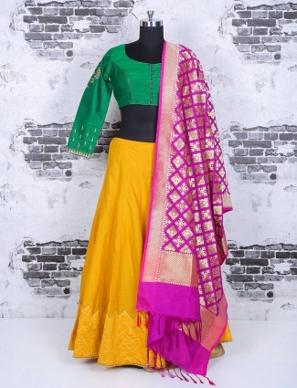 Green and yellow silk lehenga choli for festive