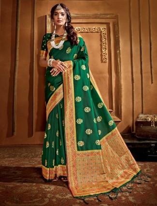 Green banarasi silk saree in zari and thread weaving