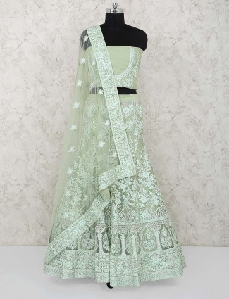 Green color net semi stitched lehenga choli