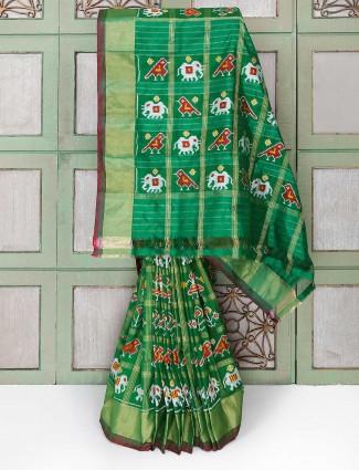 Green color patola design silk saree