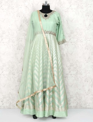 Green colored anarkali suit in cotton silk