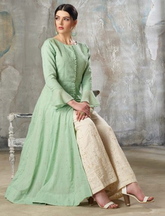 Green colored designer punjabi palazzo suit