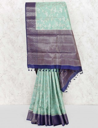 Green colored sari in semi silk fabric