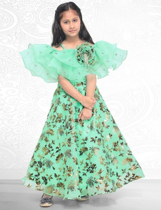 Green colored tissue silk designer gown for little girl