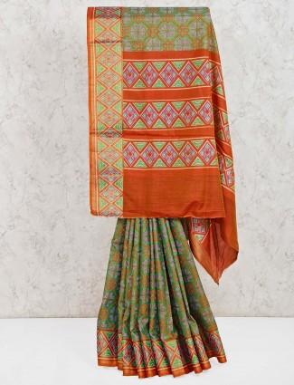 Green cotton silk patola printed saree in festive