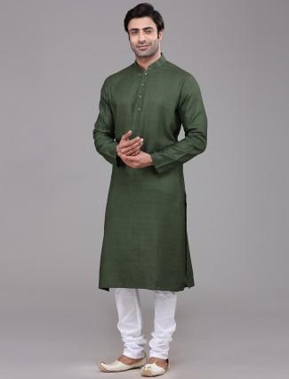 Green full sleeves silk kurta suit for festive