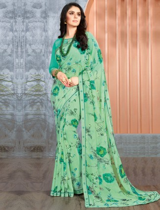 Green georgette printed saree for festive wear
