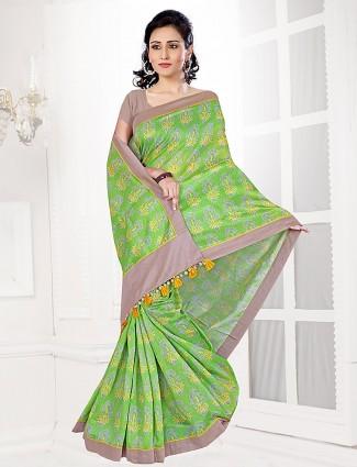 Green hue cotton printed festive saree