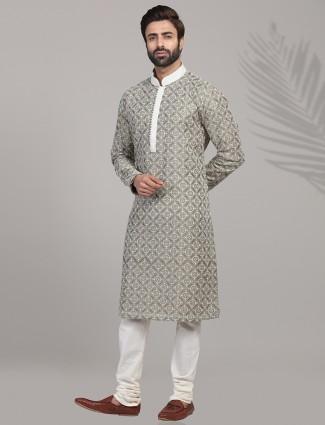 Green hue cotton silk kurta suit for festive wear
