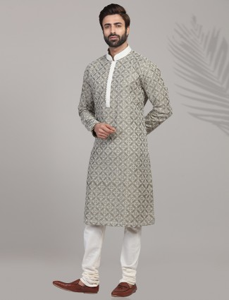 Green hue cotton silk kurta suit for festive wear
