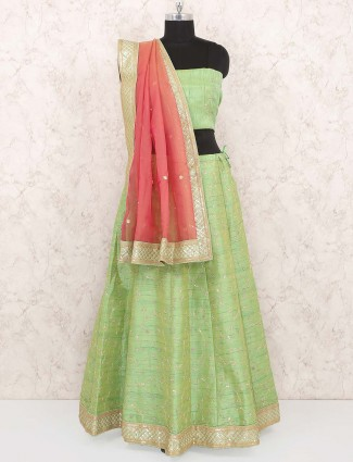 Green hue raw silk festive semi stitched lehenga choli
