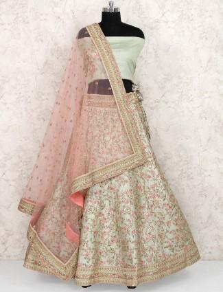 Green hue raw silk semi stitched lehenga choli
