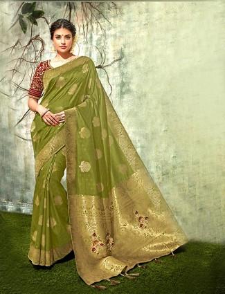 Green hued simple color semi silk saree