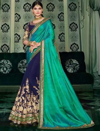 Green navy designer georgette half and half saree
