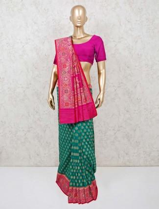 Green party wear saree in banarasi silk