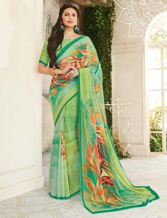Green printed regular wear saree in georgette