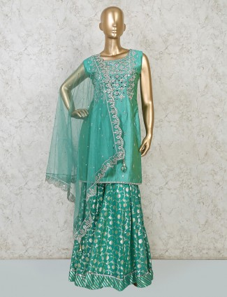 Green raw silk sharara suit for festive